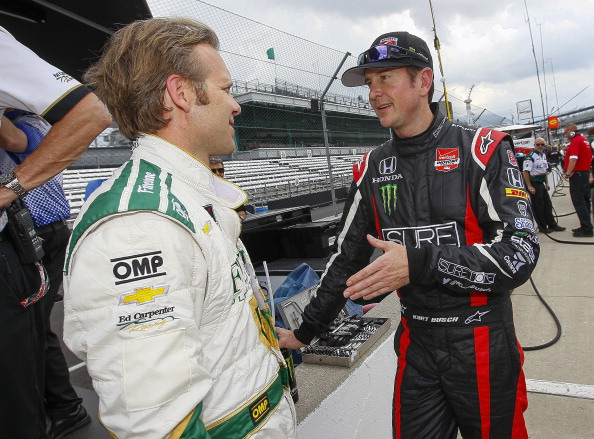 INDIANAPOLIS, IN - MAY 11: Kurt Busch driver of the #26 Honda talks to Ed Carpenter, driver of the #20 Ed Carpenter Racing Chevrolet Dallara practice for the Indy 500 at the Indianapolis Motor Speedway on May 11, 2014 in Indianapolis, Indiana. (Photo by Michael Hickey/Getty Images)