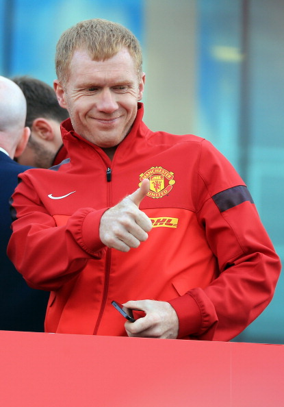 MANCHESTER, ENGLAND - MAY 13: Manchester United's Paul Scholes acknowledges the fans from an open-top bus at the start of their Barclays Premier League Trophy Parade through Manchester on May 13, 2013 in Manchester, England.  (Photo by Christopher Furlong/Getty Images)