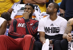 May 28, 2014; Indianapolis, IN, USA; Miami Heat forward LeBron James (left) and Miami Heat guard Dwyane Wade (right) sit on the bench during the fourth quarter in game five against the Indiana Pacers of the Eastern Conference Finals of the 2014 NBA Playoffs at Bankers Life Fieldhouse.  Indiana defeats Miami 93-90. Mandatory Credit: Brian Spurlock-USA TODAY Sports