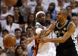 Jun 18, 2013; Miami, FL, USA; San Antonio Spurs point guard Tony Parker (9) passes against Miami Heat small forward LeBron James (6) during the first quarter of game six in the 2013 NBA Finals at American Airlines Arena.  Mandatory Credit: Derick E. Hingle-USA TODAY Sports