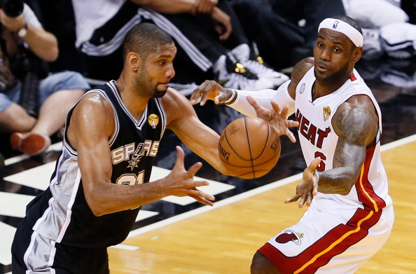 MIAMI, FL - JUNE 20:  Tim Duncan #21 of the San Antonio Spurs with the ball against LeBron James #6 of the Miami Heat in the first half during Game Seven of the 2013 NBA Finals at AmericanAirlines Arena on June 20, 2013 in Miami, Florida. NOTE TO USER: User expressly acknowledges and agrees that, by downloading and or using this photograph, User is consenting to the terms and conditions of the Getty Images License Agreement.  (Photo by Kevin C. Cox/Getty Images)