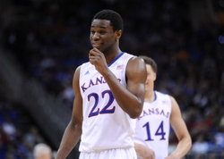 Mar 13, 2014; Kansas City, MO, USA; Kansas Jayhawks guard Andrew Wiggins (22) laughs while on the foul line during the second half against the Oklahoma State Cowboys in the second round of the Big 12 Conference college basketball tournament at Sprint Center. Kansas won 77-70 in overtime. Mandatory Credit: Denny Medley-USA TODAY Sports