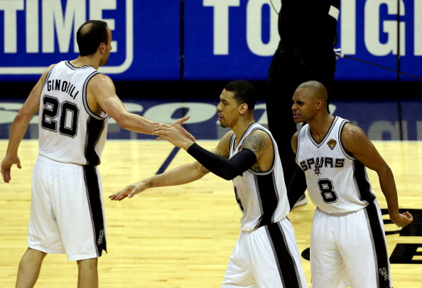 SAN ANTONIO, TX - JUNE 05:  Danny Green #4 celebrates with Manu Ginobili #20 and Patty Mills #8 of the San Antonio Spurs against the Miami Heat during Game One of the 2014 NBA Finals at the AT&T Center on June 5, 2014 in San Antonio, Texas. NOTE TO USER: User expressly acknowledges and agrees that, by downloading and or using this photograph, User is consenting to the terms and conditions of the Getty Images License Agreement.  (Photo by Chris Covatta/Getty Images)