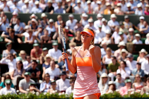 PARIS, FRANCE - JUNE 07:  Maria Sharapova of Russia celebrates a point during her women's singles final match against Simona Halep of Romania on day fourteen of the French Open at Roland Garros on June 7, 2014 in Paris, France.  (Photo by Matthew Stockman/Getty Images)