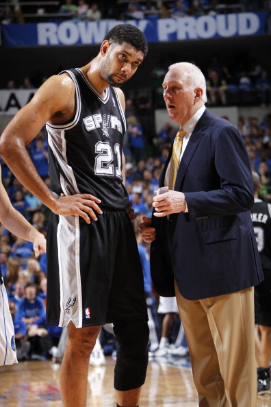 DALLAS, TX - APRIL 26:  Gregg Popovich of the San Antonio Spurs talks to Tim Duncan #21 during the game against the Dallas Mavericks during Game Three of the Western Conference Quarterfinals during the 2014 NBA Playoffs on April 26, 2014 at the American Airlines Center in Dallas, Texas. NOTE TO USER: User expressly acknowledges and agrees that, by downloading and/or using this Photograph, user is consenting to the terms and conditions of the Getty Images License Agreement. Mandatory Copyright Notice: Copyright 2013 NBAE (Photo by Glenn James/NBAE via Getty Images)