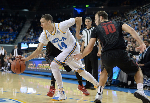 LOS ANGELES, CA - JANUARY 23:  Zach LaVine #14 of the UCLA Bruins dribbles past Robbie Lemons #10 of the Stanford Cardinal during a 91-74 UCLA win at Pauley Pavilion on January 23, 2014 in Los Angeles, California.  (Photo by Harry How/Getty Images)
