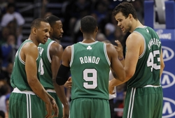 Jan 19, 2014; Orlando, FL, USA; Boston Celtics point guard Rajon Rondo (9) talks with point guard Avery Bradley (L) and center Kris Humphries (R) against the Orlando Magic during the second half  at Amway Center. Orlando Magic won 93-91. Mandatory Credit: Kim Klement-USA TODAY Sports