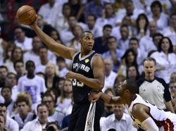 Jun 12, 2014; Miami, FL, USA; San Antonio Spurs forward Boris Diaw (33) keeps the ball away from Miami Heat guard Dwyane Wade (3) during the second quarter of game four of the 2014 NBA Finals at American Airlines Arena. Mandatory Credit: Bob Donnan-USA TODAY Sports