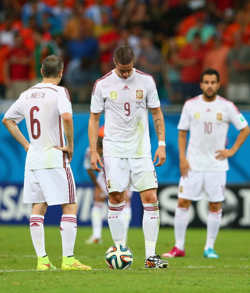 SALVADOR, BRAZIL - JUNE 13:  (L - R) Andres Iniesta; Fernando Torres and Cesc Fabregas of Spain look dejected pduring the 2014 FIFA World Cup Brazil Group B match between Spain and Netherlands at Arena Fonte Nova on June 13, 2014 in Salvador, Brazil.  (Photo by Quinn Rooney/Getty Images)