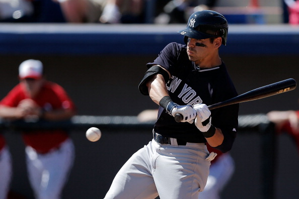 VIERA, FL - MARCH 11:  Jacob Ellsbury #22 of the New York Yankees takes a pitch against the Washington Nationals in the sixth inning of a game at the Space Coast Stadium on March 11, 2014 in Viera, Florida.  (Photo by Stacy Revere/Getty Images)