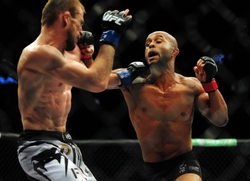 Jun 14, 2014; Vancouver, British Columbia, Canada; Demetrious Johnson (red) fights against Ali Bagautinov (blue) in the flyweight title bout at UFC 174 at Rogers Arena. Mandatory Credit: Anne-Marie Sorvin-USA TODAY Sports