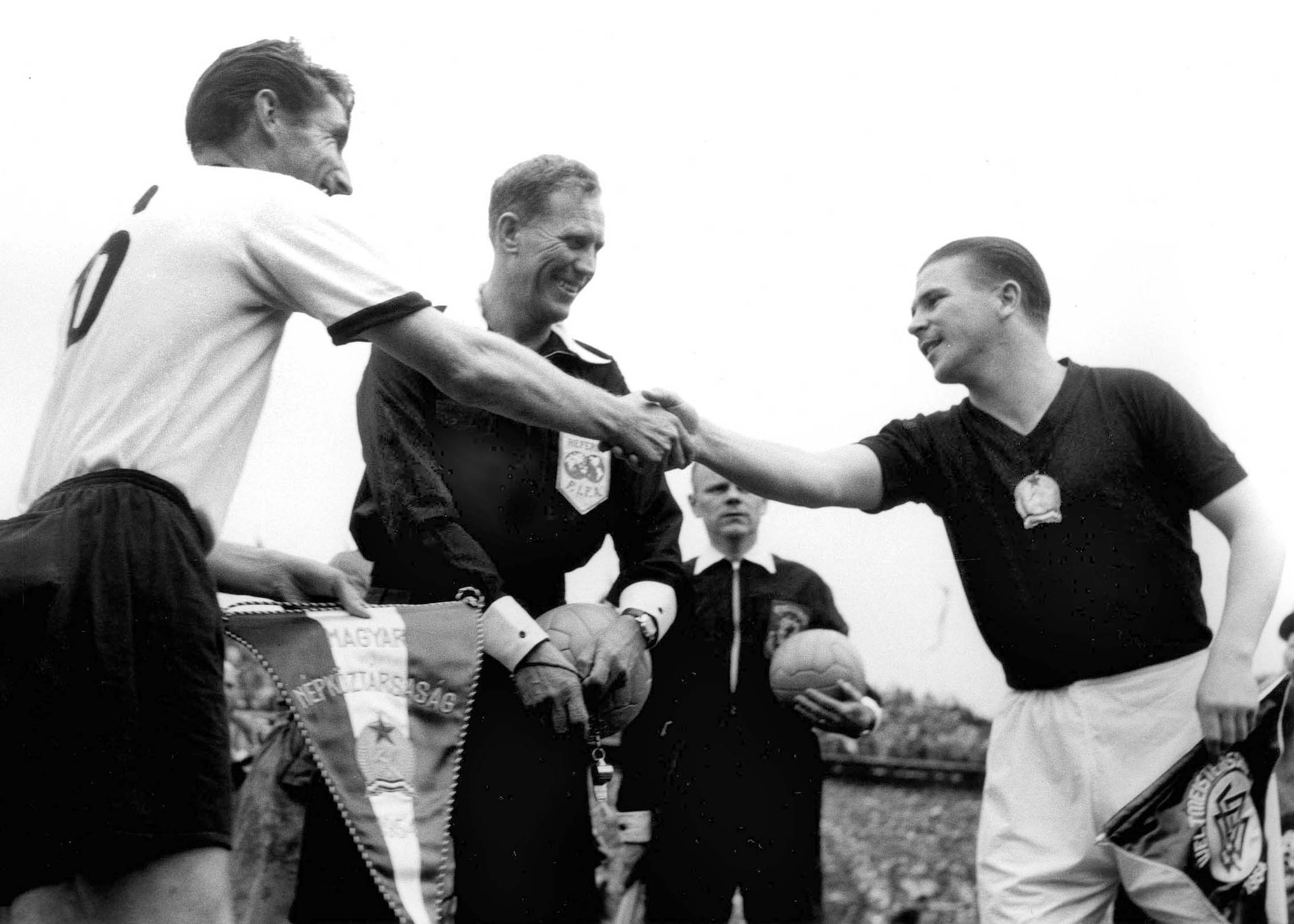German captain Fritz Walter, partly obscure centre right, and right half Horst Eckel, number 9, are chaired by the crowd after winning the Football World Cup, in Basle, Switzerland, on July 4, 1954. Germany beat Hungary 3-2 in the Final and received the Jules Rimet Trophy. (AP Photo)