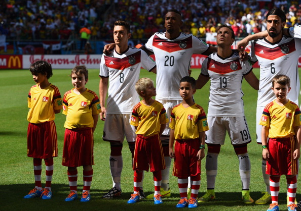 SALVADOR, BRAZIL - JUNE 16:  Mesut Oezil, Jerome Boateng, Mario Goetze and Sami Khedira of Germany look on before the 2014 FIFA World Cup Brazil Group G match between Germany and Portugal at Arena Fonte Nova on June 16, 2014 in Salvador, Brazil.  (Photo by Stu Forster/Getty Images)
