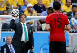 Jun 17, 2014; Fortaleza, Ceara, BRAZIL; Mexico manager Miguel Herrera tosses the ball to Mexico defender Hector Moreno (15) during the first half of the 2014 World Cup game against Brazil at Estadio Castelao. Mandatory Credit: Winslow Townson-USA TODAY Sports