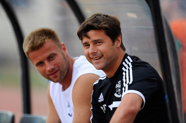 GIRONA, SPAIN - JULY 17:  Manager Mauricio Pochettino (R) and Artur Boruc of Southampton looks on during a friendly match between Southampton FC and UE Llagostera at the Josep Pla i Arbones Stadium on July 17, 2013 in Girona, Spain.  (Photo by David Ramos/Getty Images)