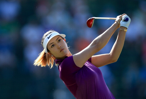 PINEHURST, NC - JUNE 20:  Michelle Wie of the USA plays her tee shot at the par 4, 13th hole during the second round of the 69th U.S. Women's Open at Pinehurst Resort & Country Club, Course No. 2, on June 20, 2014 in Pinehurst, North Carolina.  (Photo by David Cannon/Getty Images)
