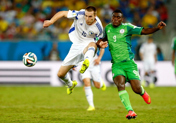 CUIABA, BRAZIL - JUNE 21:  Toni Sunjic of Bosnia and Herzegovina and Emmanuel Emenike of Nigeria compete for the ball during the 2014 FIFA World Cup Group F match between Nigeria and Bosnia-Herzegovina at Arena Pantanal on June 21, 2014 in Cuiaba, Brazil.  (Photo by Phil Walter/Getty Images)