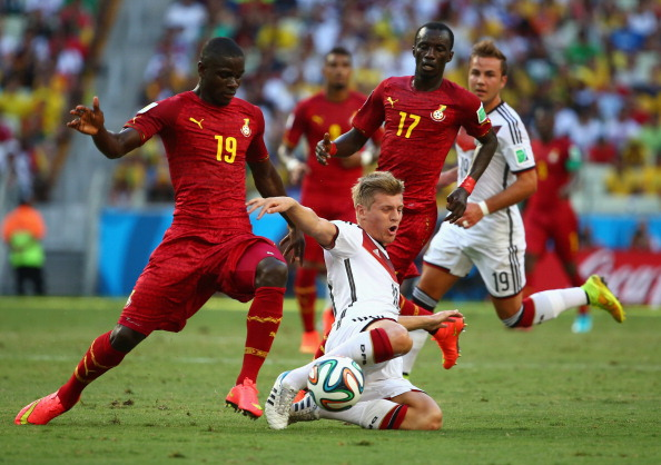 FORTALEZA, BRAZIL - JUNE 21:  Toni Kroos of Germany is challenged by Jonathan Mensah (L) and Mohammed Rabiu of Ghana during the 2014 FIFA World Cup Brazil Group G match between Germany and Ghana at Castelao on June 21, 2014 in Fortaleza, Brazil.  (Photo by Robert Cianflone/Getty Images)