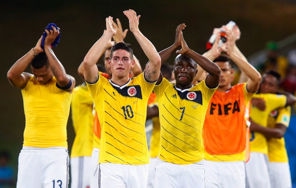 CUIABA, BRAZIL - JUNE 24:  James Rodriguez (L) and Pablo Armero (R) of Colombia acknowledge the fans after the 2014 FIFA World Cup Brazil Group C match between Japan and Colombia at Arena Pantanal on June 24, 2014 in Cuiaba, Brazil.  (Photo by Gabriel Rossi/Getty Images)