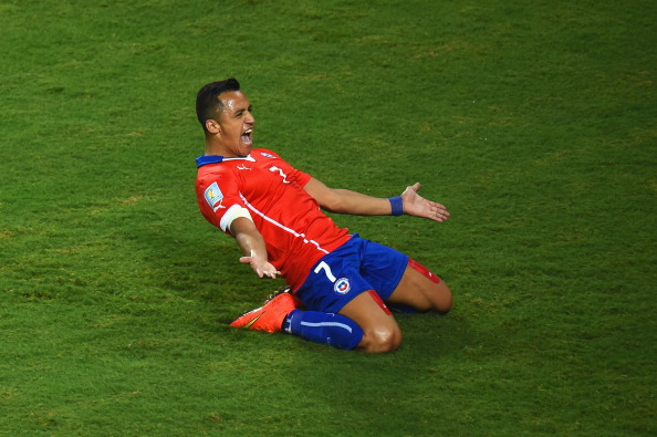 CUIABA, BRAZIL - JUNE 13:  Alexis Sanchez of Chile celebrates after scoring his team's first goal during the 2014 FIFA World Cup Brazil Group B match between Chile and Australia at Arena Pantanal on June 13, 2014 in Cuiaba, Brazil.  (Photo by Stu Forster/Getty Images)