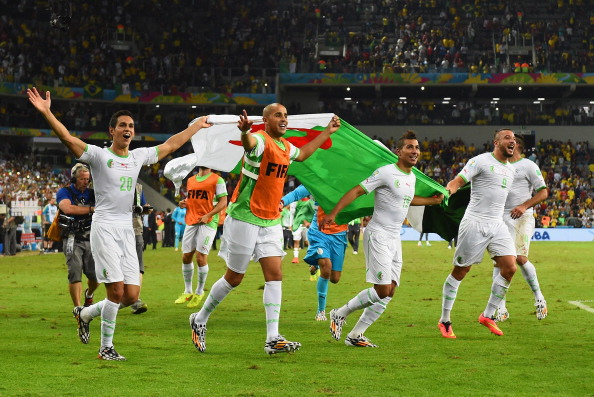 CURITIBA, BRAZIL - JUNE 26:  Aissa Mandi (L) and Madjid Bougherra of Algeria celebrate with teammates after a 1-1 tie during the 2014 FIFA World Cup Brazil Group H match between Algeria and Russia at Arena da Baixada on June 26, 2014 in Curitiba, Brazil.  (Photo by Matthias Hangst/Getty Images)