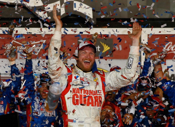 DAYTONA BEACH, FL - FEBRUARY 23:  Dale Earnhardt Jr., driver of the #88 National Guard Chevrolet, celebrates in Victory Lane after winning during the NASCAR Sprint Cup Series Daytona 500 at Daytona International Speedway on February 23, 2014 in Daytona Beach, Florida.  (Photo by Tom Pennington/Getty Images)