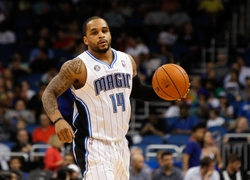 Mar 12, 2014; Orlando, FL, USA; Orlando Magic guard Jameer Nelson (14) drives to the basket against the Denver Nuggets during the second half at Amway Center. Denver Nuggets defeated the Orlando Magic 120-112. Mandatory Credit: Kim Klement-USA TODAY Sports