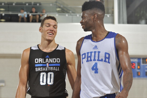 ORLANDO, FL - JULY 5: Aaron Gordon #00 of the Orlando Magic speaks with Nerlens Noel #4 of the Philadelphia 76ers during a game on July 5, 2014 at Amway Center in Orlando, Florida. NOTE TO USER: User expressly acknowledges and agrees that, by downloading and or using this photograph, User is consenting to the terms and conditions of the Getty Images License Agreement. Mandatory Copyright Notice: Copyright 2014 NBAE  (Photo by Fernando Medina/NBAE via Getty Images)