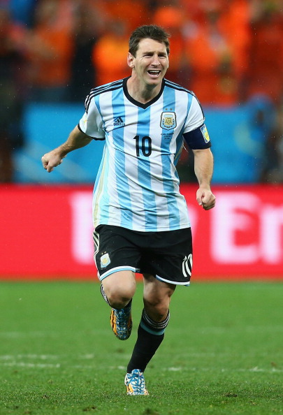 SAO PAULO, BRAZIL - JULY 09:  Lionel Messi of Argentina celebrates defeating the Netherlands in a shootout during the 2014 FIFA World Cup Brazil Semi Final match between the Netherlands and Argentina at Arena de Sao Paulo on July 9, 2014 in Sao Paulo, Brazil.  (Photo by Ronald Martinez/Getty Images)