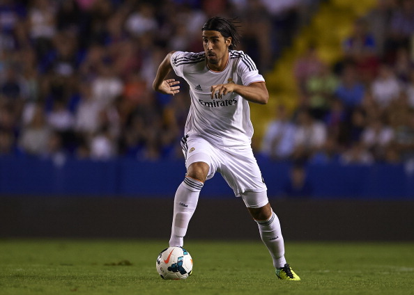 VALENCIA, SPAIN - OCTOBER 05:  Sami Khedira of Real Madrid runs with the ball during the La Liga match between Levante UD and Real Madrid at Ciutat de Valencia on October 5, 2013 in Valencia, Spain.  (Photo by Manuel Queimadelos Alonso/Getty Images)