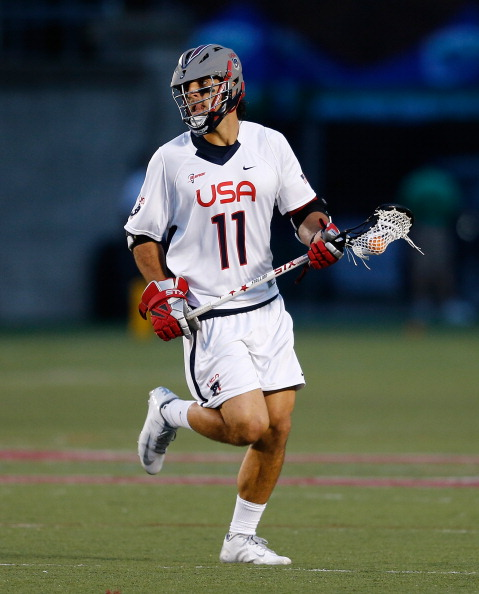 BOSTON, MA - JUNE 26: Paul Rabil #11 of Team USA competes against Team MLL in the fourth quarter during the 2014 MLL All Star Game at Harvard Stadium on June 26, 2014 in Boston, Massachusetts.  (Photo by Jim Rogash/Getty Images)