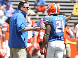 April 6, 2013; Gainesville FL, USA; Florida Gators running back coach  Brain White talks with running back Kelvin Taylor (21) during the spring practice for the Orange and Blue Deput at Ben Hill Griffin Stadium. Mandatory Credit: Kim Klement-USA TODAY Sports