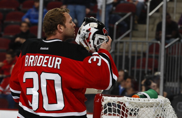 NEWARK, NJ - OCTOBER 29:   Martin Brodeur #30 of the New Jersey Devils stands in goal against the Tampa Bay Lightning at the Prudential Center on October 29, 2013 in Newark, New Jersey. (Photo by Jeff Zelevansky/Getty Images)