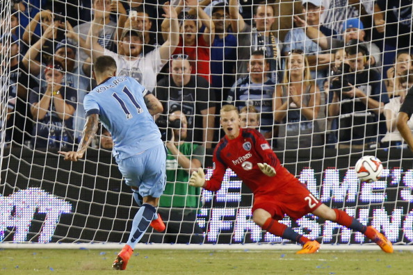 KANSAS CITY, KS - JULY 23: Dedryck Boyata #11 of Manchester City scores a goal past Jon Kempin #21 of Sporting KC during a penalty kick early in the second half on July 23rd at Sporting Park in Kansas City, Kansas. (Photo by Kyle Rivas/Getty Images)