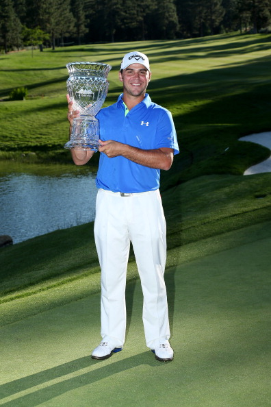 RENO, NV - AUGUST 04:  Gary Woodland poses with the trophy after his victory during the final round of the Reno-Tahoe Open at Montreaux Golf and Country Club on August 4, 2013 in Reno, Nevada.  (Photo by Stephen Dunn/Getty Images)