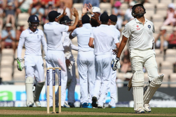 SOUTHAMPTON, ENGLAND - JULY 29: Rohit Sharma (R) of India shows his frustration after being caught by Stuart Broad off the bowling of Moeen Ali of England during day three of the 3rd Investec Test match between England and India at the Ageas Bowl at Ageas Bowl on July 29, 2014 in Southampton, England.  (Photo by Michael Steele/Getty Images)