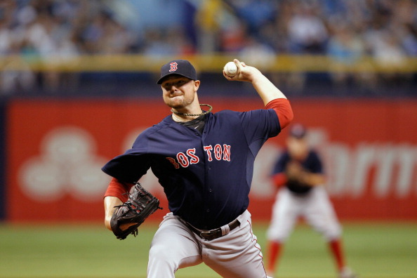 ST PETERSBURG, FL - JULY 25:  Jon Lester #31 of the Boston Red Sox pitches during the first inning against the Tampa Bay Rays at Tropicana Field on July 25, 2014 in St Petersburg, Florida.  (Photo by Scott Iskowitz/Getty Images)