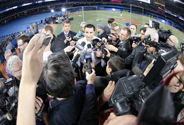 TORONTO, CANADA - APRIL 4: General manager Alex Anthopoulos of the Toronto Blue Jays talks to media befoe MLB game action against the New York Yankees on April 4, 2014 at Rogers Centre in Toronto, Ontario, Canada. (Photo by Tom Szczerbowski/Getty Images)