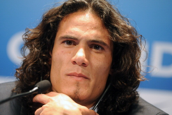 PARIS, FRANCE - JULY 16: Paris Saint-Germain's (PSG) new forward, Edinson Cavani, attends a press conference on July 16, 2013 in Paris, France. Cavani's transfer to Paris Saint-Germain football club is reported to have cost in the region of £55m. (Photo by Antoine Antoniol/Getty Images)