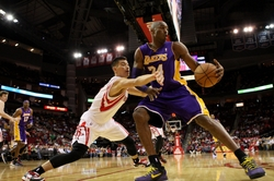 Dec 4, 2012; Houston, TX, USA; Los Angeles Lakers shooting guard Kobe Bryant (24) drives the ball during the first quarter as Houston Rockets point guard Jeremy Lin (7) defends at Toyota Center. Mandatory Credit: Troy Taormina-USA TODAY Sports