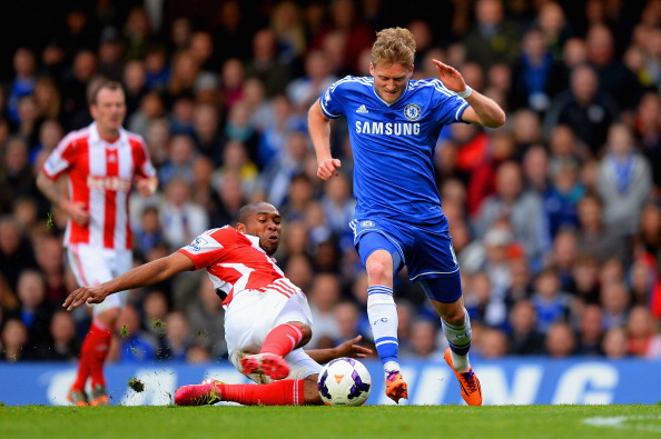 LONDON, ENGLAND - APRIL 05:  Wilson Palacios of Stoke City tackles Andre Schurrle of Chelsea during the Barclays Premier League match between Chelsea and Stoke City at Stamford Bridge on April 5, 2014 in London, England.  (Photo by Mike Hewitt/Getty Images)