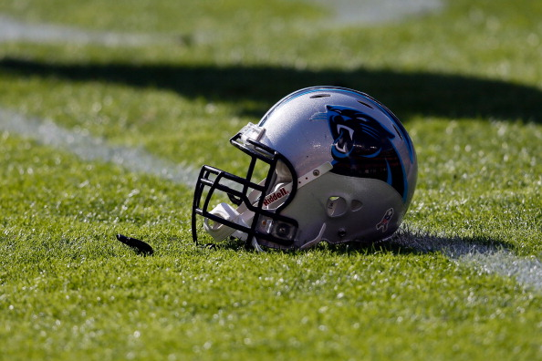 LANDOVER, MD - NOVEMBER 04: A Carolina Panthers helmet sits on the grass as the team warms up before the start of their game against the Washington Redskins at FedExField on November 4, 2012 in Landover, Maryland.  (Photo by Rob Carr/Getty Images)