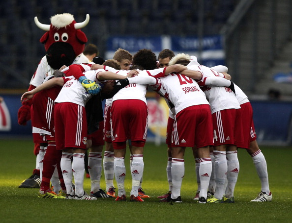 SALZBURG, AUSTRIA - MARCH 23: Players of Salzburg and their mascot stay together before the tipp3 Bundesliga match between Red Bull Salzburg and SC Wiener Neustadt at Red Bull Arena on March 23, 2014 in Salzburg, Austria.  (Photo by Simon Hausberger/Getty Images)
