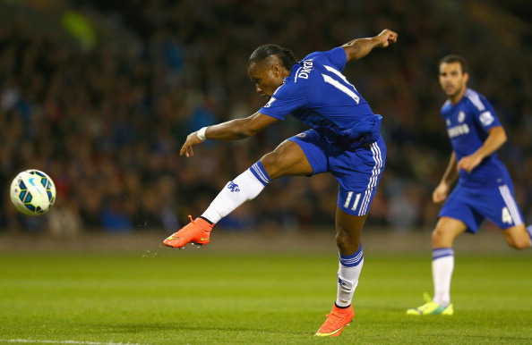 BURNLEY, ENGLAND - AUGUST 18:  Didier Drogba of Chelsea shoots at goal during the Barclays Premier League match between Burnley and Chelsea at Turf Moor on August 18, 2014 in Burnley, England.  (Photo by Clive Brunskill/Getty Images)