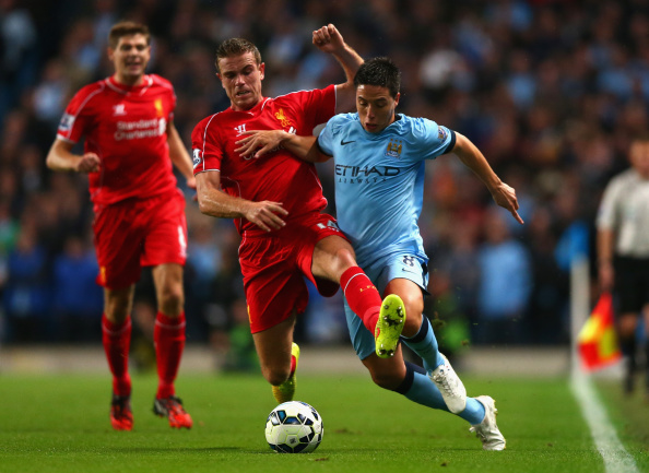 MANCHESTER, ENGLAND - AUGUST 25:  Jordan Henderson of Liverpool battles with Samir Nasri of Manchester City during the Barclays Premier League match between Manchester City and Liverpool at the Etihad Stadium on August 25, 2014 in Manchester, England.  (Photo by Clive Brunskill/Getty Images)