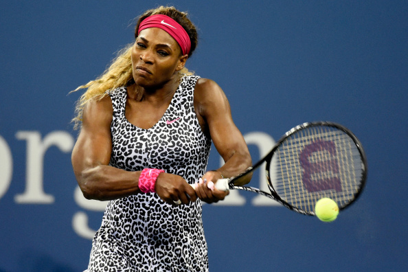 NEW YORK, NY - AUGUST 26:  Serena Williams of the United States returns a shot to Taylor Townsend of the United States during their women's singles first round match on Day Two of the 2014 US Open at the USTA Billie Jean King National Tennis Center on August 26, 2014  in the Flushing neighborhood of the Queens borough of New York City.  (Photo by Alex Goodlett/Getty Images)