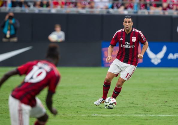 CHARLOTTE, NC - AUGUST 02: Adil Mai #13 of A.C. Milan passes the ball during first half action against Liverpool in the Guinness International Champions Cup at Bank of America Stadium on August 2, 2014 in Charlotte, North Carolina. Liverpool defeated A.C. Milan 2-0. (Photo by Brian A. Westerholt/Getty Images)