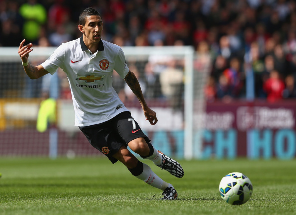 BURNLEY, ENGLAND - AUGUST 30:  Angel di Maria of Manchester United runs with the ball during the Barclays Premier League match between Burnley and Manchester United at Turf Moor on August 30, 2014 in Burnley, England.  (Photo by Clive Brunskill/Getty Images)