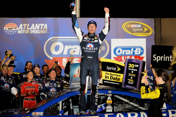 HAMPTON, GA - AUGUST 31:  Kasey Kahne, driver of the #5 Farmers Insurance Chevrolet, celebrates in Victory Lane after winning the NASCAR Sprint Cup Series Oral-B USA 500 at Atlanta Motor Speedway on August 31, 2014 in Hampton, Georgia.  (Photo by Jonathan Moore/Getty Images)