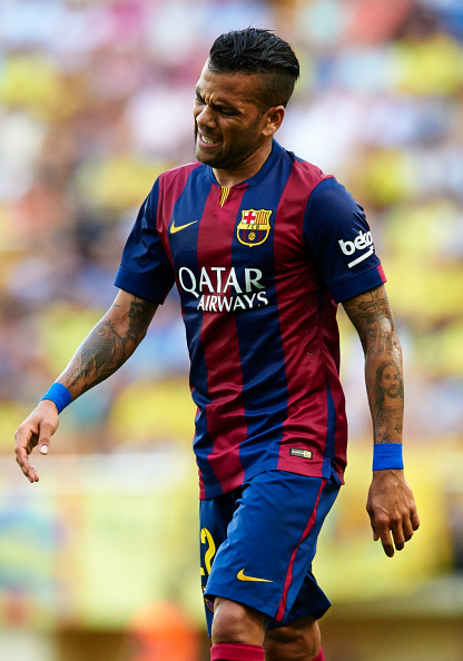 VILLARREAL, SPAIN - AUGUST 31:  Dani Alves of Barcelona gestures during the La Liga match between Villarreal CF and FC Barcelona at El Madrigal stadium on August 31, 2014 in Villarreal, Spain.  (Photo by Manuel Queimadelos Alonso/Getty Images)